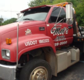 Mel's Auto Towing truck